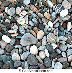 Abstract background texture - colorful pebbles on the sea beach