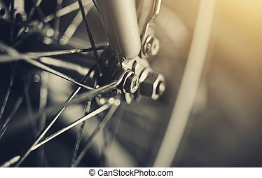 Abstract background with a bicycle wheel with bokeh