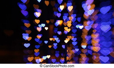 abstract background with colored lights in the shape of hearts