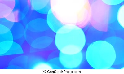 Abstract background with shining blue bokeh sparkles.