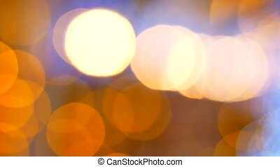 Abstract background with shining yellow bokeh sparkles.