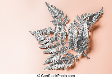 Abstract beige background with silver plant branch
