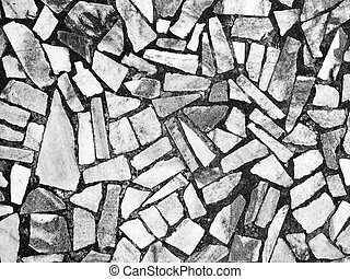 Abstract black and white stone mosaic background