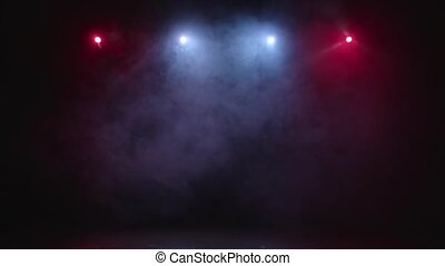 Abstract blue and red spot light with smoke on black background