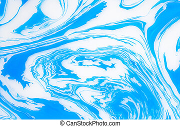 Abstract blue marble background. Stains of paint on the water.