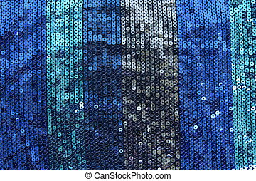Abstract blue spangles background.