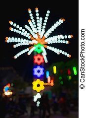 Abstract blur and bokeh of lights at temple in Thailand. Ferris wheel Lights blurred.