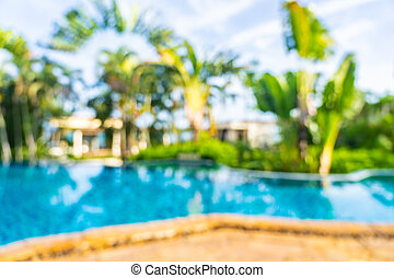 Abstract blur and defocus beautiful outdoor swimming pool in hotel resort