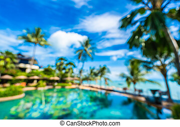 Abstract blur and defocus luxury outdoor swimming pool in hotel resort