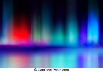 abstract blur and reflection of red and blue radiance of...