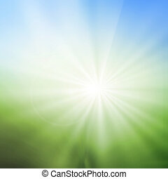 abstract blur background of green grass field and blue sky above