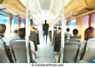 Abstract blur Background of People on Airconditioned Public Transportation Bus.