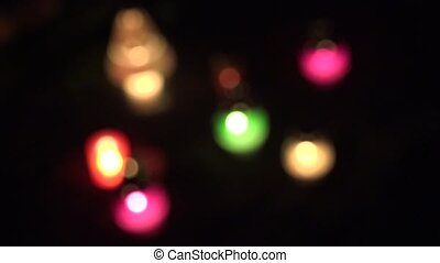 abstract blur colourful with church candles light in dark. 4K