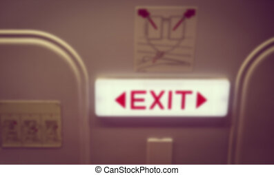 Abstract blur Emergency exit in aircraft ( Filtered image processed vintage effect. )