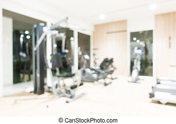 Abstract blur fitness and gym interior with sport equipment