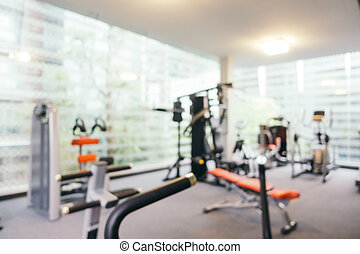 Abstract blur fitness equipment in gym