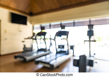 Abstract blur fitness equipment in gym interior