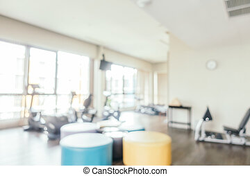 Abstract blur fitness equipment in gym room interior