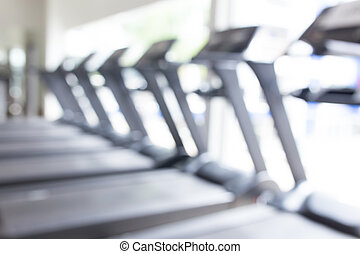 Abstract blur fitness gym with equipment for background