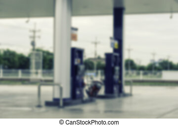 abstract blur of gas station on vintage filter