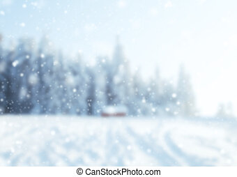 abstract blur winter background with snowy branches