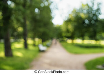 abstract blurred background of city park in sunny summer day