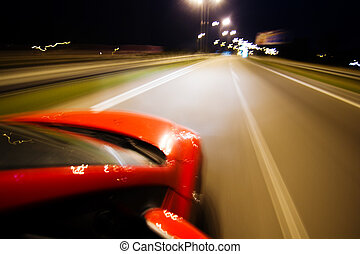 Abstract blurred background with red car and lot of lights