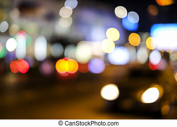 Abstract blurred bokeh background of car light on road in the city