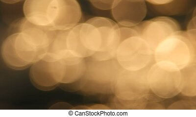 Abstract blurred golden color light reflection of sun in water