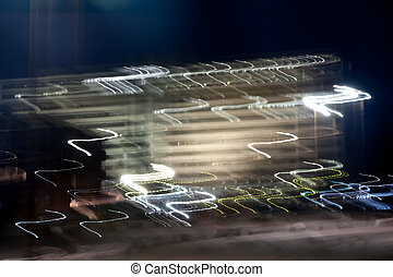 Abstract blurred light effect on a black background. Long exposure photo of moving camera