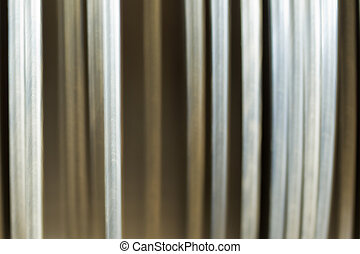 abstract blurred vertical lines of white and brown dinner plates