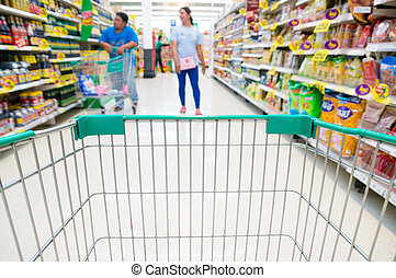 Abstract blurred photo of store with trolley in Supermarket store bokeh background