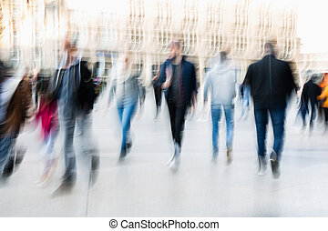 abstract blurred picture of people in the city