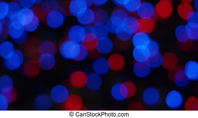 Abstract bokeh background of Christmas night, blue red lights outdoor. Round colorful bokeh Shine in the dark, 4K Video