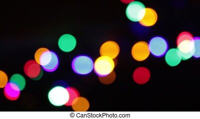 Abstract bokeh holiday background. Decorative twinkling garlands. Christmas and new year lights blinking. Celebration spirit in merry flashing colorful polygons on dark night backdrop in full HD clip