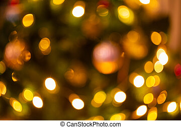 Abstract bokeh light on black background with flare. Christmas concept to present celebration wallpaper decor with beautiful glitter and sparkle bubbles in blur or defocus style for web design.