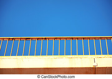 Abstract bridge close-up with blue sky as copy space.