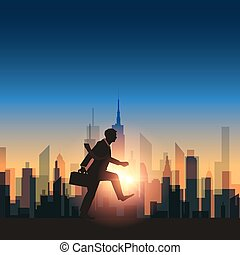 Abstract businessman walking with sunset city background