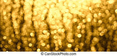 Abstract Christmas blurred background. A Golden-brown glow of Bokeh.