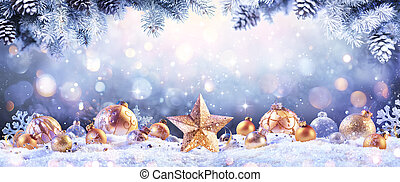Abstract Christmas Card - Golden Ornament On snow With Fir Branches And Defocused Lights