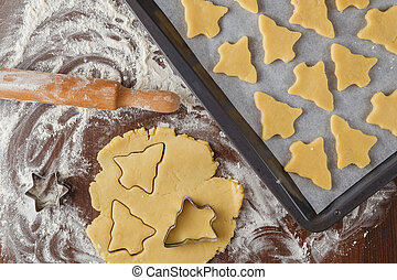 Abstract Christmas food background with cookies molds and...