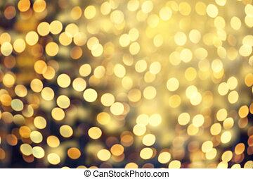 Abstract Christmas glitter vintage lights background. Dark...