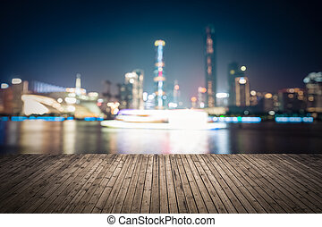 abstract cityscape background with wooden floor at night