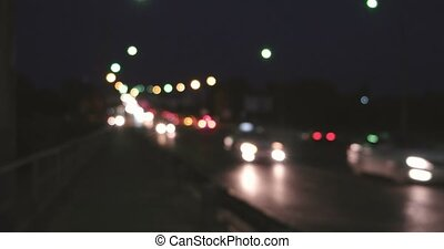 Abstract cityscape blurred background. Night view of modern overpass crowded with illuminated cars and tracks