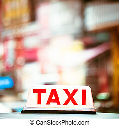 Abstract cityscape with taxi car at night city. Hong Kong