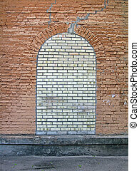 abstract closed brick stone window on the stone wall, construction details