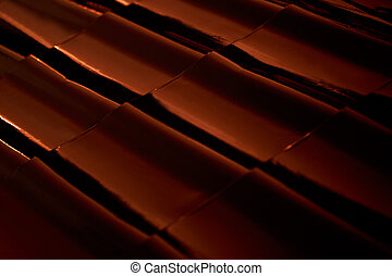 Abstract closeup metal profile roof-tile at sunset.
