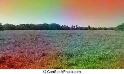 Abstract color drone shot going over field - Color overlay...