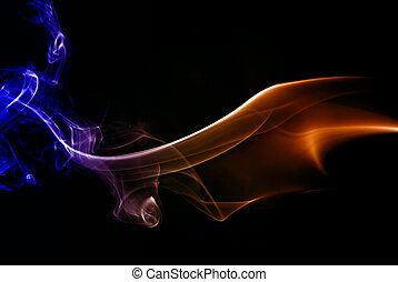 smoke - abstract colored smoke on a black background