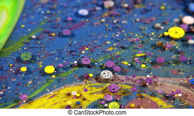 Abstract Colorful Acrylic Paint Sphere Spreads on Water